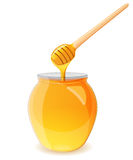 A jar of honey and spoon for honey stock image