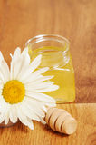 Jar of honey and a spoonful of honey Royalty Free Stock Images