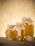 Jar of honey and stick Stock Photo