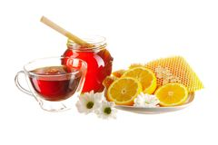 Jar of honey and tea cup Royalty Free Stock Image