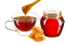 Jar of honey and tea cup Stock Image