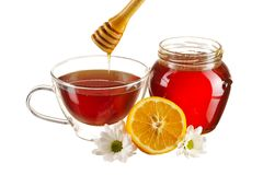 Jar of honey and tea cup Royalty Free Stock Photography