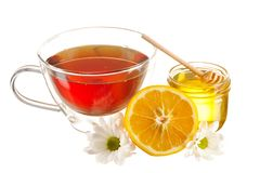 Jar of honey and tea cup Royalty Free Stock Images