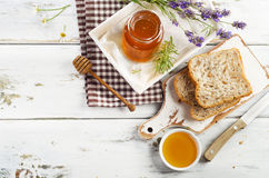 Jar of honey  and toast for breakfast. Stock Photos