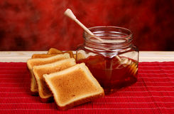 Jar of honey and toasts Royalty Free Stock Photo