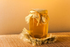 Jar honey vintage wooden Stock Photography