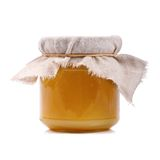 Jar of honey  on white Royalty Free Stock Photo