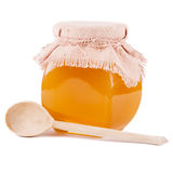 Jar of honey on a white background Royalty Free Stock Photography