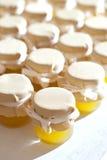 Jar of honey on white table jam Stock Image