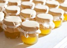 Jar of honey on white table jam Royalty Free Stock Photo