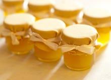 Jar of honey on white table jam Royalty Free Stock Photography