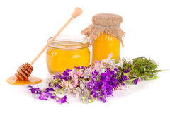 Jar of honey with wildflowers isolated on white background Royalty Free Stock Photo