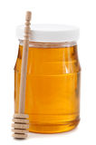 Jar of honey with wood stick Stock Photos