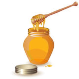 Jar of honey with wooden dipper Stock Images