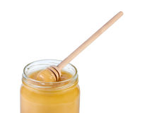 Jar honey and wooden spoon. Royalty Free Stock Photography
