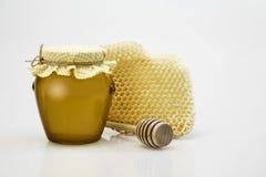 Jar of honey. Honey jar with wooden spoon Stock Photo