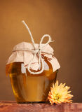 Jar of honey on wooden table Royalty Free Stock Photo