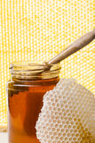 Jar of honey with yellow background. Jar of honey with wooden and proper background Royalty Free Stock Photos