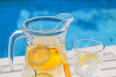 A jar of ice cold water with lemon and orange Stock Photography