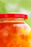 Jar of jam. Glass jar with white cherries close up Royalty Free Stock Photo