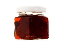 Jar with jam. Strawberry jam on the white background royalty free stock images