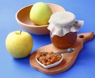 Jar of jam and apple Stock Photos