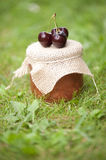 Jar of jam with cherries royalty free stock image