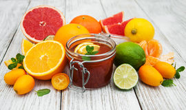Jar of jam and fresh citrus fruits Royalty Free Stock Image