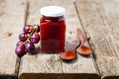 Jar of jam and grapes Stock Photography