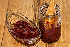 Jar with a jam from quince. On a wooden table Stock Image
