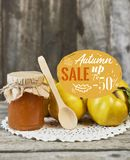 jar of jam with spoon and quinces with leaves on wooden rustic b royalty free stock photography