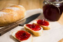Jar of jam and toasts stock photo