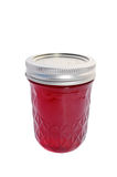 Jar of jelly. Yummy jar filled with fruit jelly royalty free stock photography