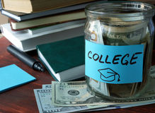 Jar with label college and money on the table. Stock Photo