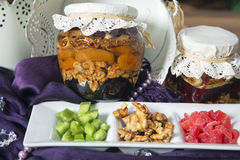 Jar of layered fruits with honey and dried fruit mix. Royalty Free Stock Photo
