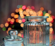 A jar with lights. A jar with a bokeh of lights in the background Stock Photos