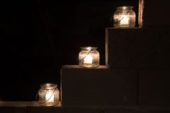 Jar lights on steps in darkness Royalty Free Stock Photo