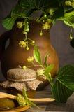 Jar with lime honey on a table Stock Photos