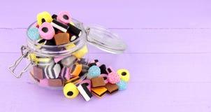 Jar Of Liquorice Allsorts Candy. Jar filled with  traditional liquorice allsorts candy Royalty Free Stock Images