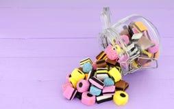 Jar Of Liquorice Allsorts Candy. Jar filled with  traditional liquorice allsorts candy Royalty Free Stock Photo