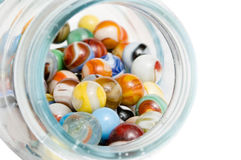 Jar of marbles. A jar of vintage marbles isolated on white Royalty Free Stock Photos