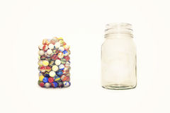 Jar and marbles Stock Image