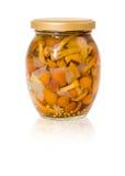 Jar of marinated mushrooms Royalty Free Stock Photos