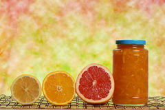 Jar of marmalade with fruits Royalty Free Stock Photos