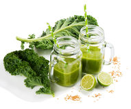 Jar mason mugs of kale smoothie. Stock Images