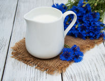 Jar of milk and cornflowers Stock Image