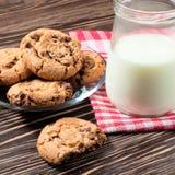 Jar of milk and tasty cookies Stock Image