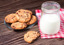 Jar of milk and tasty cookies Stock Photos