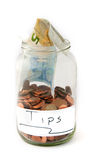 Jar with money for tips Royalty Free Stock Images