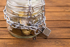 Jar with money on wooden table stock photos